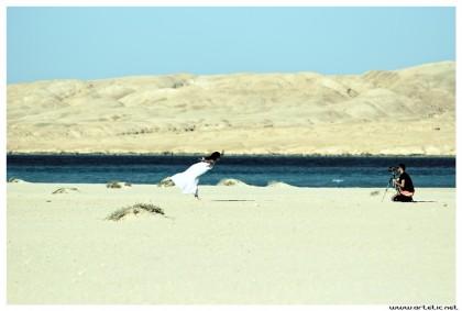 Model posing on Mahmya Beach