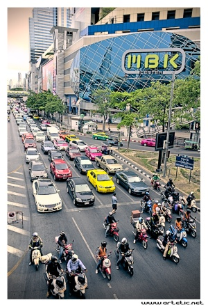 Cars and moto swarn in the streets of Bangkok at Traffic jam time