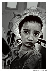 Small girl in a theatre in Aguelmouss, Morocco