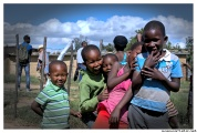 Sotho children playing during adults slaughter sheeps