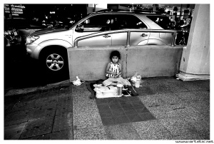 Girl begging for money in Bangkok