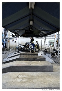 There are a lot of motorcycles in Bangkok, many of them used as taxis. They also have their dedicated washing stations