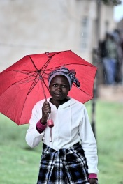 The girl with a red ombrella